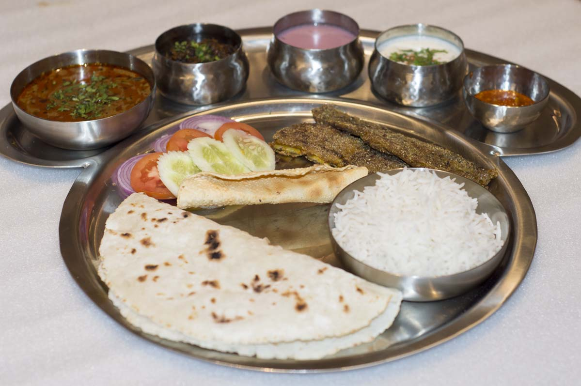 rice and chapati in thali
